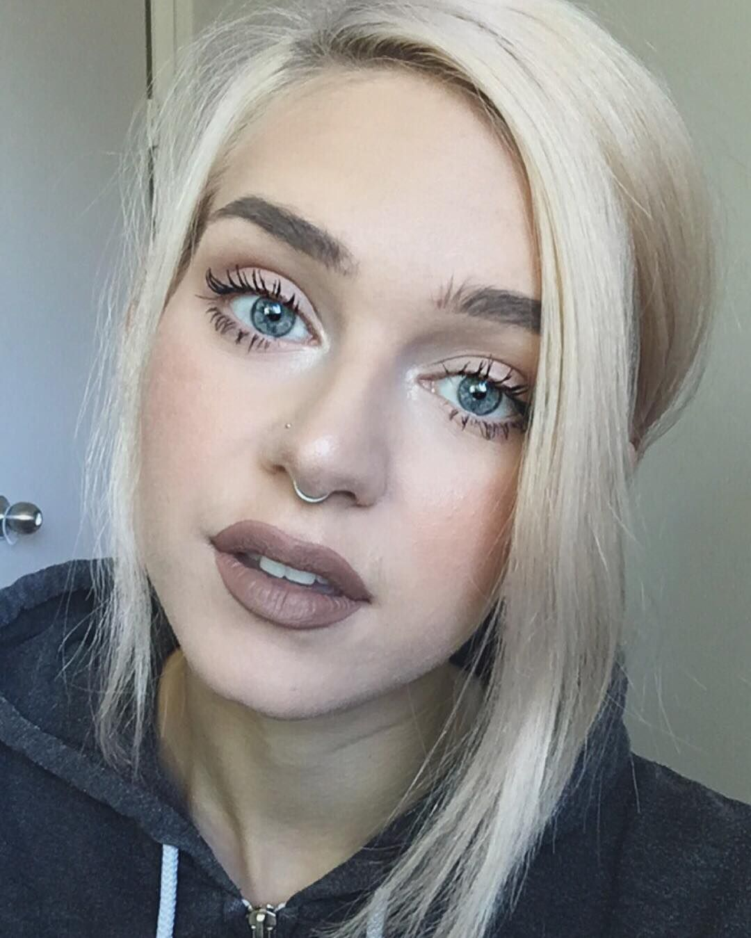 Bull nose piercing  Neutral makeup with extreme side part and septum piercing