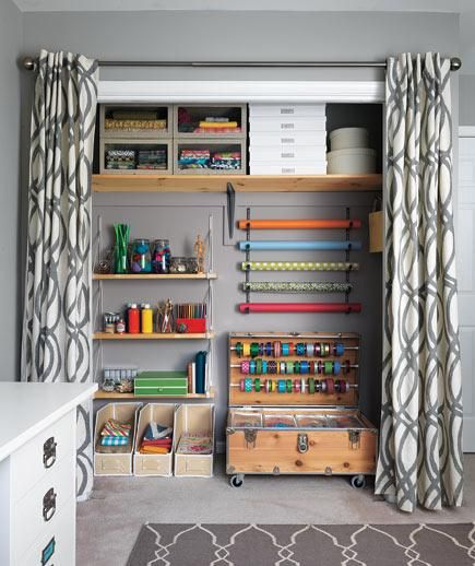 Genius craft room makeover hacks (including a wall-mounted bike rack serving as a wrapping-paper caddy).