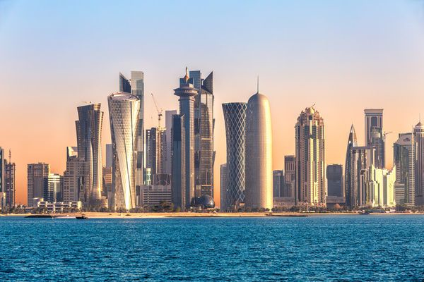 Photograph-Doha skyline and harbor at sunset, Qatar, Middle East-10