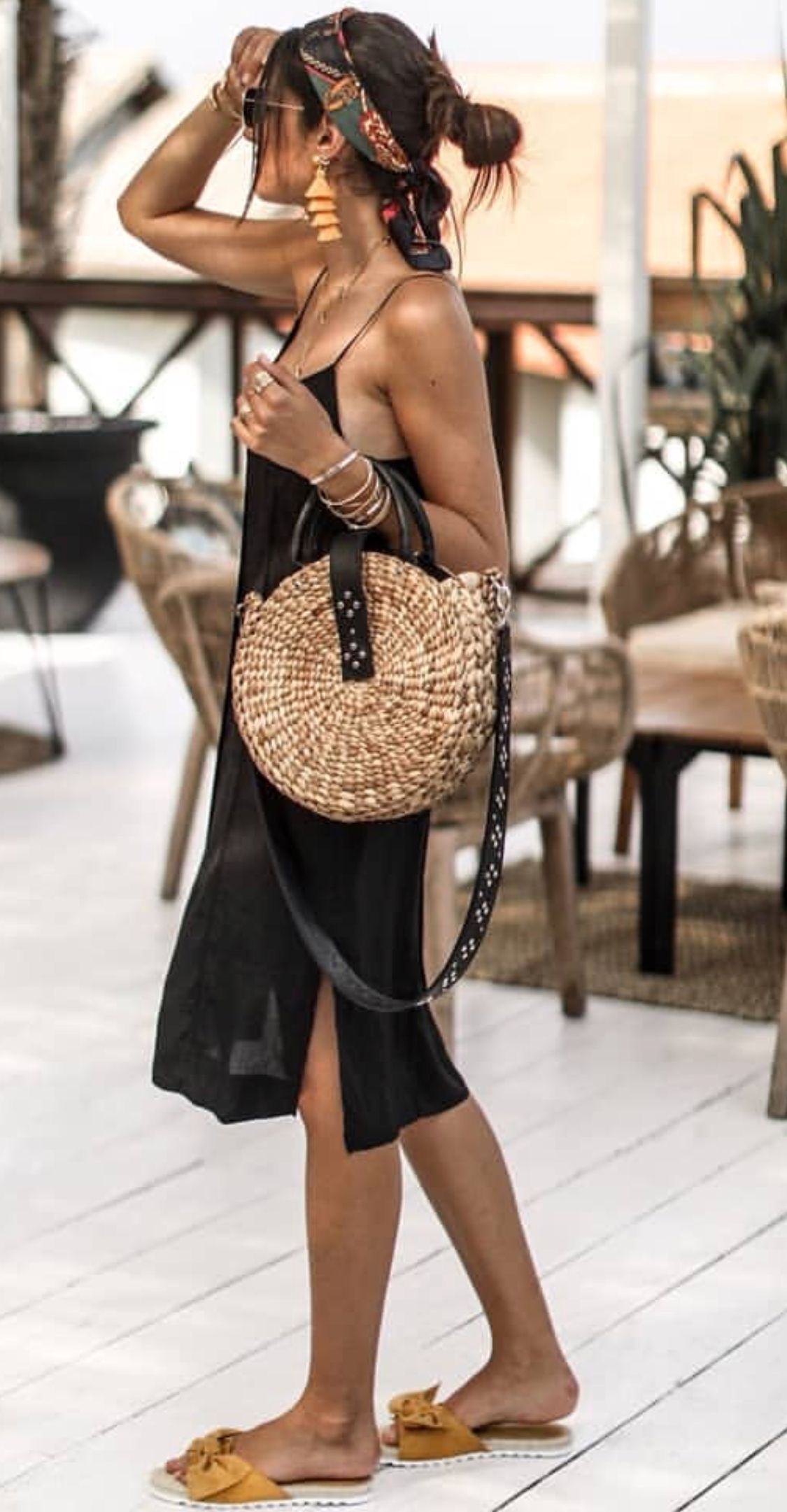 Casual vacation outfit with trendy straw handbag. #vacationlooks
