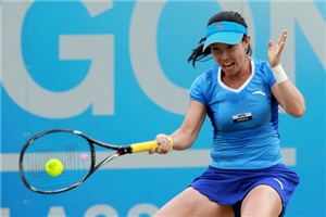 Jie Zheng of China hits a return during her match against Anne Keothavong of Great Britain during day three of the AEGON Classic at Edgbaston Priory Club on June 13, 2012 in Birmingham, England.