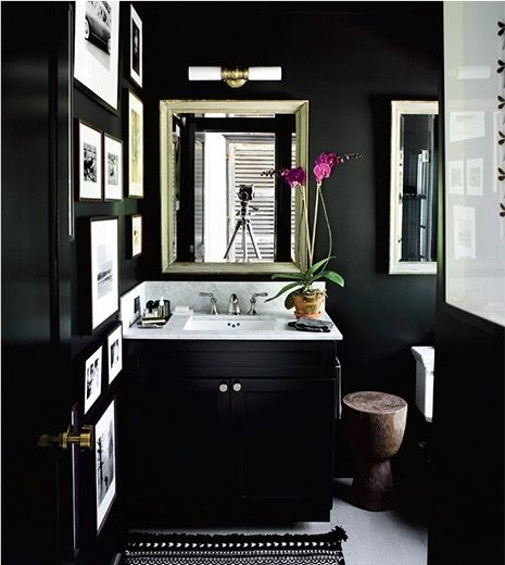 black bathroom, black walls, black cabinets, powder room