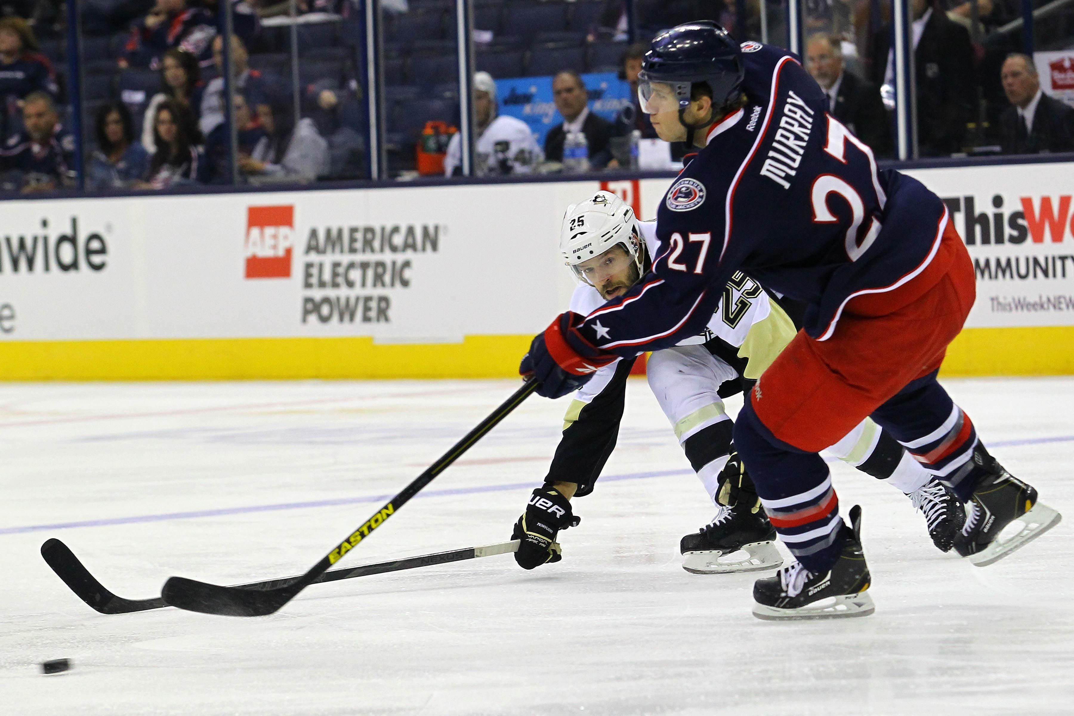 CrowdCam Hot Shot: Columbus Blue Jackets defenseman Ryan Murray passes the puck in front of Pittsburgh Penguins forward Andrew Ebbett during the 1st period at Nationwide Arena. Photo by Rob Leifheit