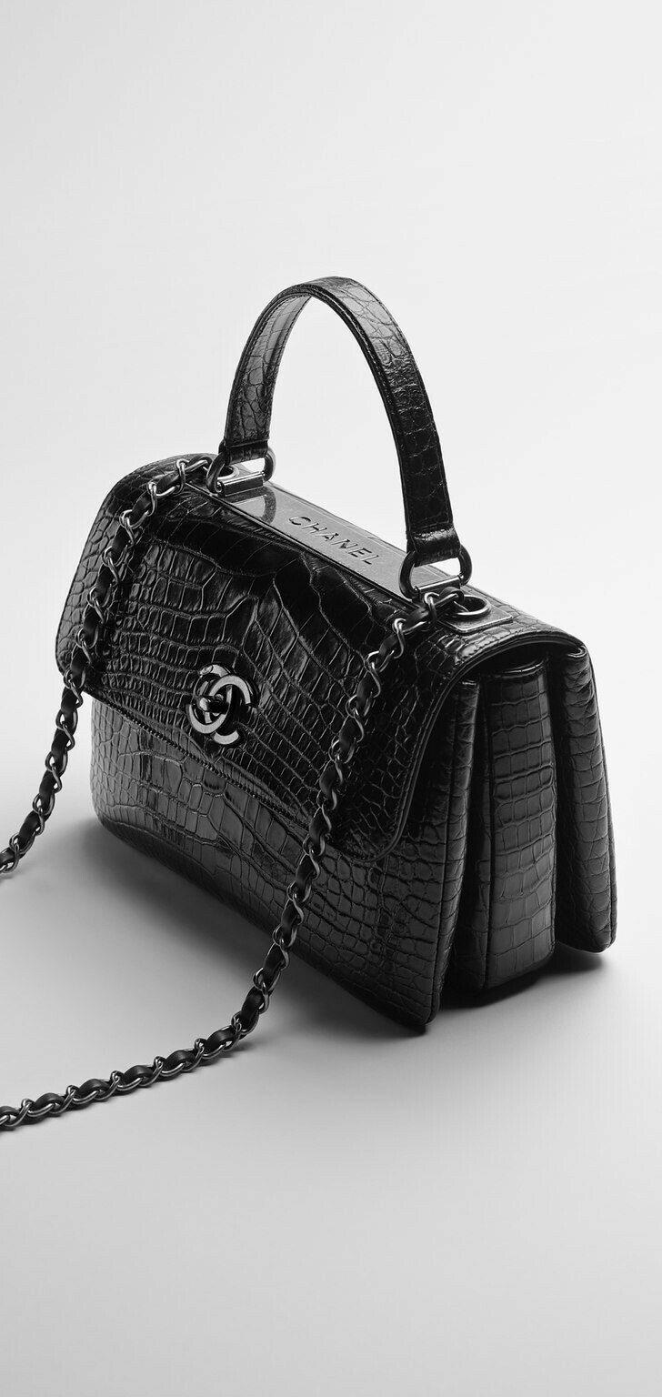 f16b8701e209c Alligator flap bag embellished with.
