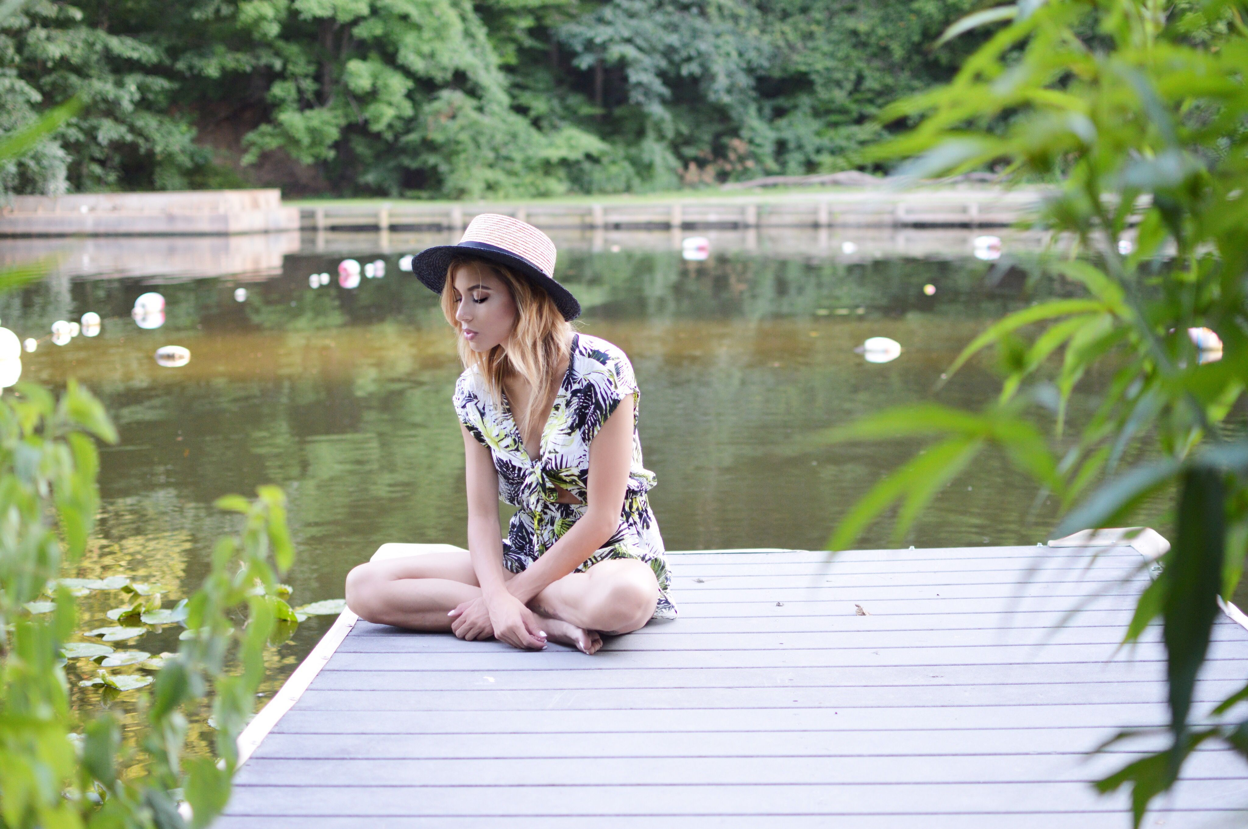 Street style hats // Tie-front romper and boaters hat // TheDistrictDarlings