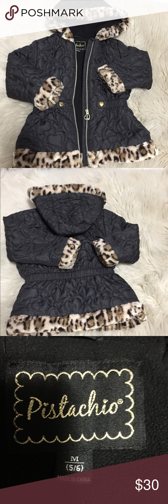 Faux Fur Trimmed Girls Coat Quilted black with any male print faux fur trim around hood, sleeves, hem. New condition with working zipper, no snags, tears, and CLEAN! Pistachio Brand, in black, selling for $70 on Amazon. Pistachio Jackets & Coats Puffers