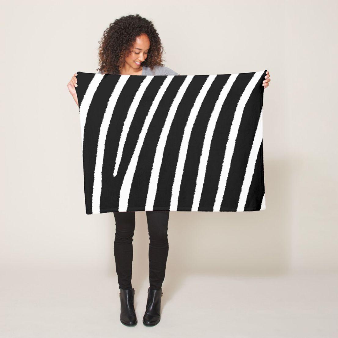 Modern fleece blanket with zebra stripes pattern in home
