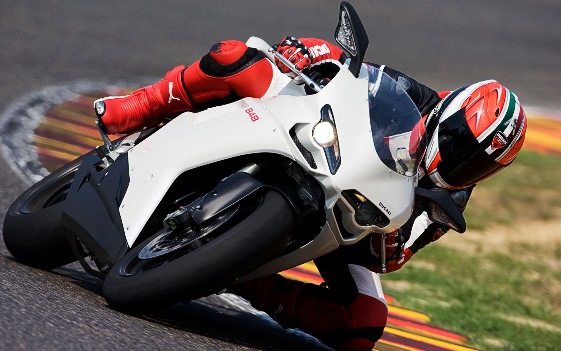 Dangerous Sports Motorcycle Racing Low In The Corner With