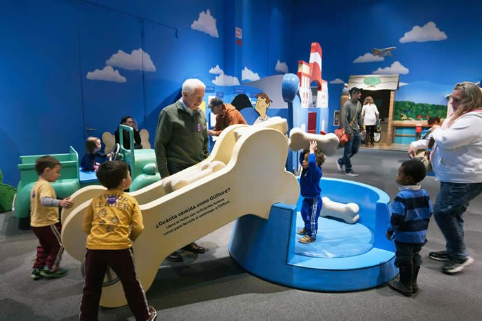 Dog toys as large set pieces (Clifford exhibit for children's museums)