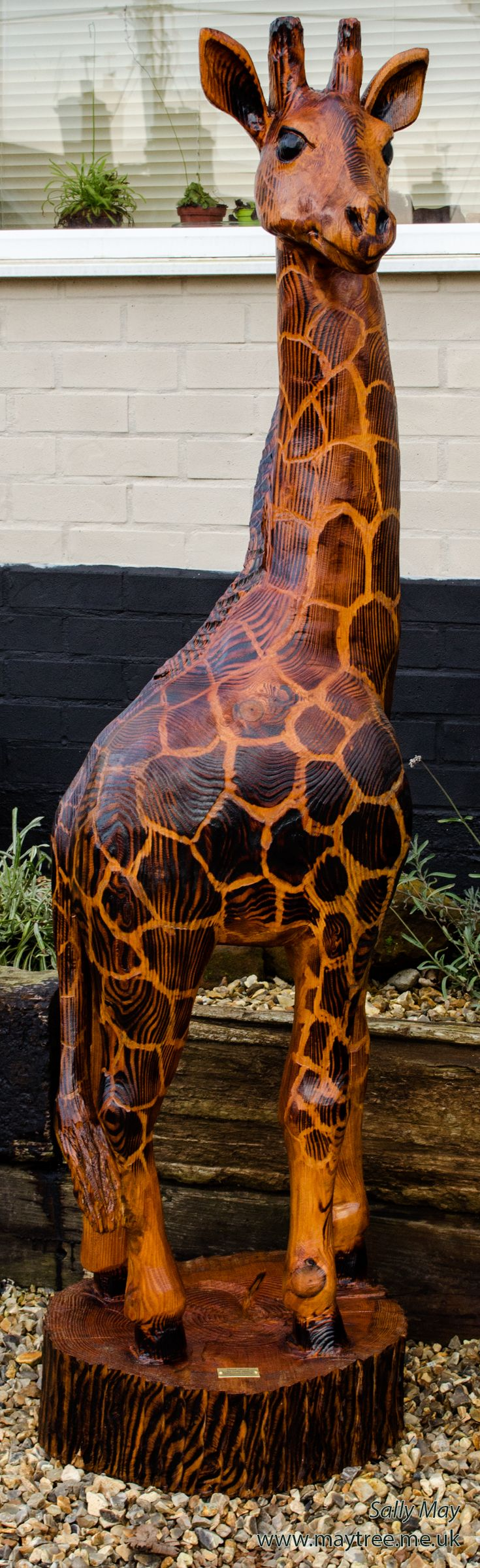 Giraffe. Chainsaw carving by Sally May