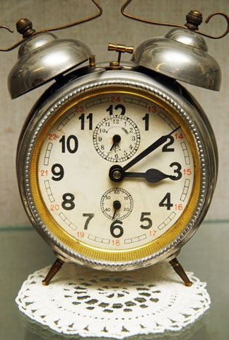 Antique style alarm clock with legs and bells