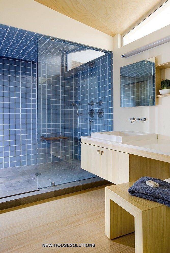 Modern bathroom includes recycled glass tile bamboo