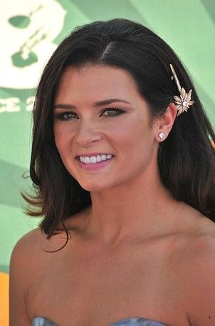 Danica Patrick sports a simple hair piece  to add a sparkle to her natural hair.
