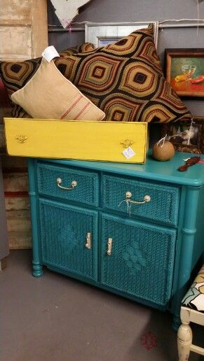 Turquoise wood and wicker dresser
