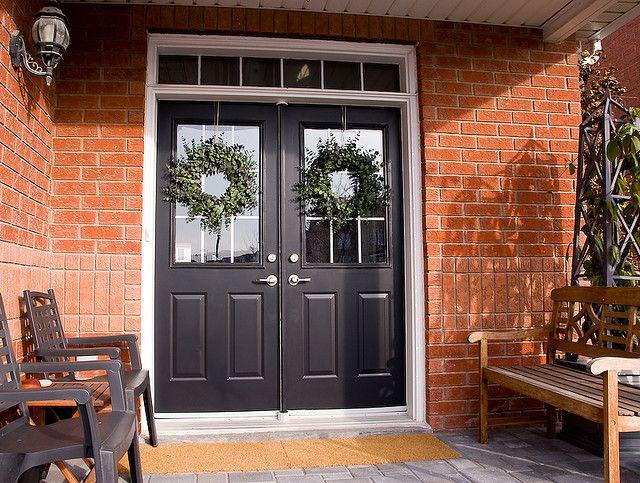 black double front doors. black door, red brick. paint front doorsfront double doors