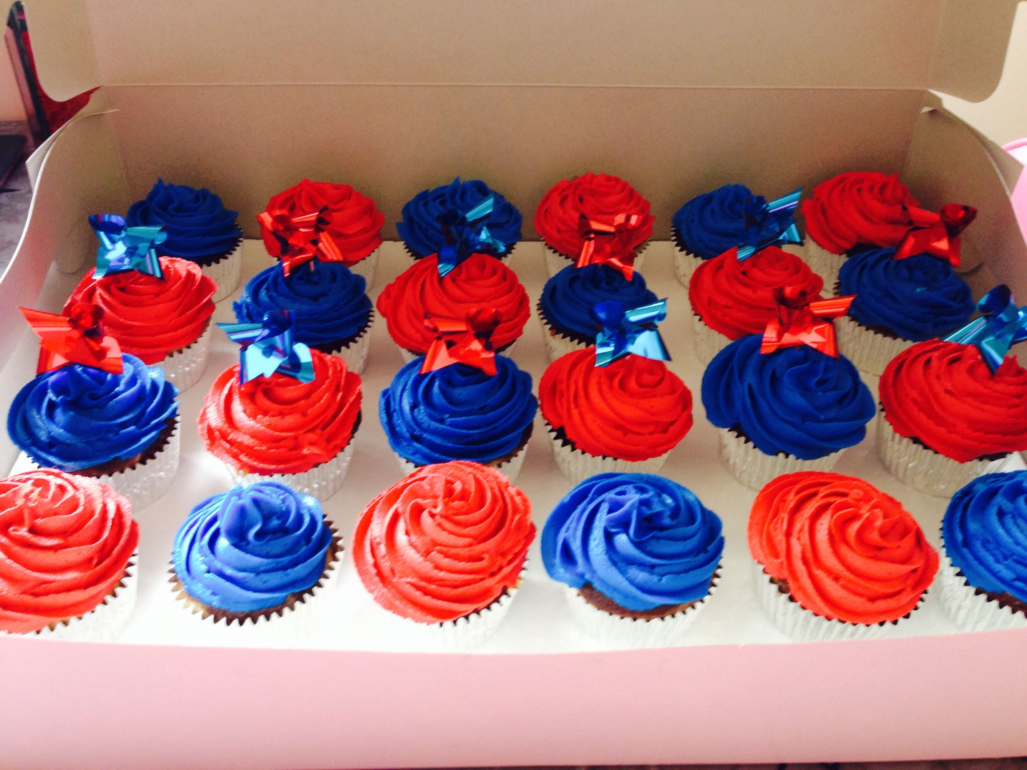 Red and blue cupcakes for a friend's kid's birthday party