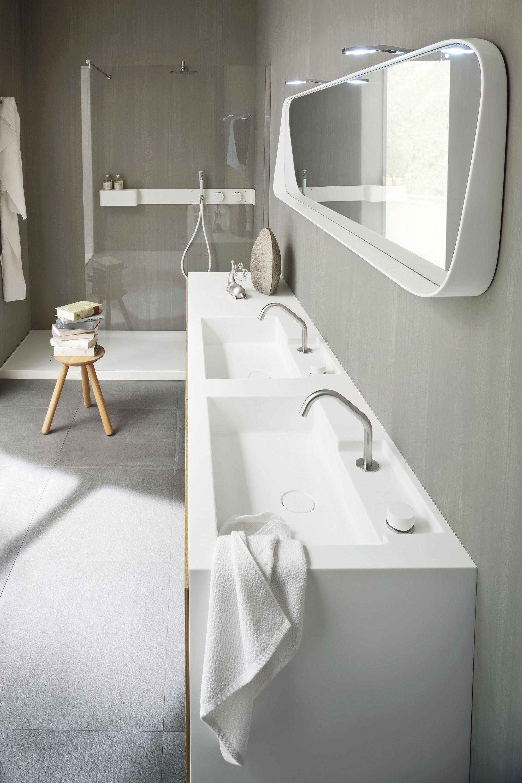 Mobile lavabo sospeso in Corian® con ante Mobile lavabo doppio ...