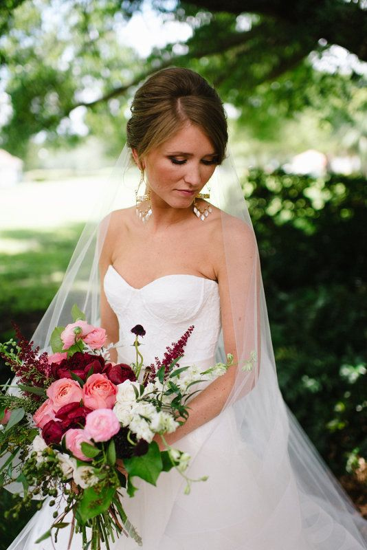bridal bouquet is a loosely hand tied clutch of rich summer shades of light to deep pinks, rich tones of burgundy, creamy white and freshly cut local greenery.