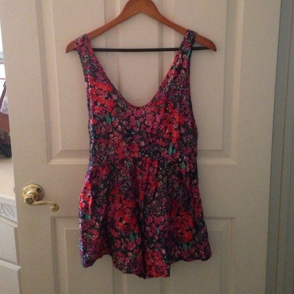 "Kaitlyn Floral Romper Floral, Flowy romper from the store Kaitlyn.  Has a V- neck in the front and a deeper V-Neck in the back. The sides/ sleeves are cut a little low, showing some skin. There's also a zipper in the back. Tag doesn't say what size it is. However, I'm about 5""4 with a 26 waist and it fits loose. Super cute and comfortable, perfect for spring and summer!  Kaitlyn Pants Jumpsuits & Rompers"