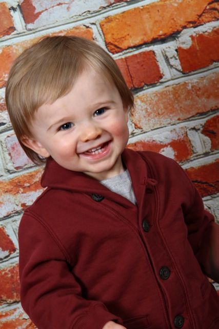 Big grin on a brick background taken at sears portrait studios