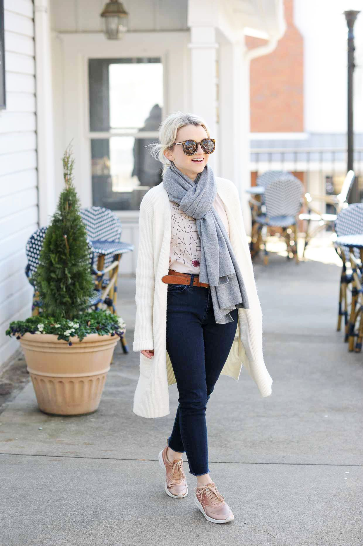 f24a3f09dc24 Blush graphic tee+dark skinny jeans+pink sneakers+white long  cardigan+cognac belt+grey scarf+sunglasses. Fall Casual Outfit 2017