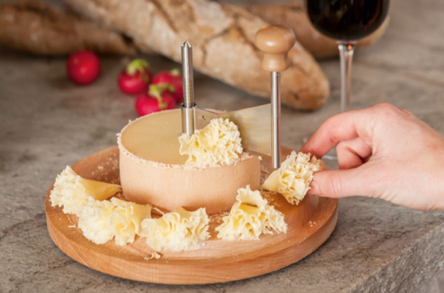 A cheese curling knife you can also use for chocolate… although why you'd want to is beyond me. | 28 Gifts To Make Any Cheese Lover's Dreams Come True