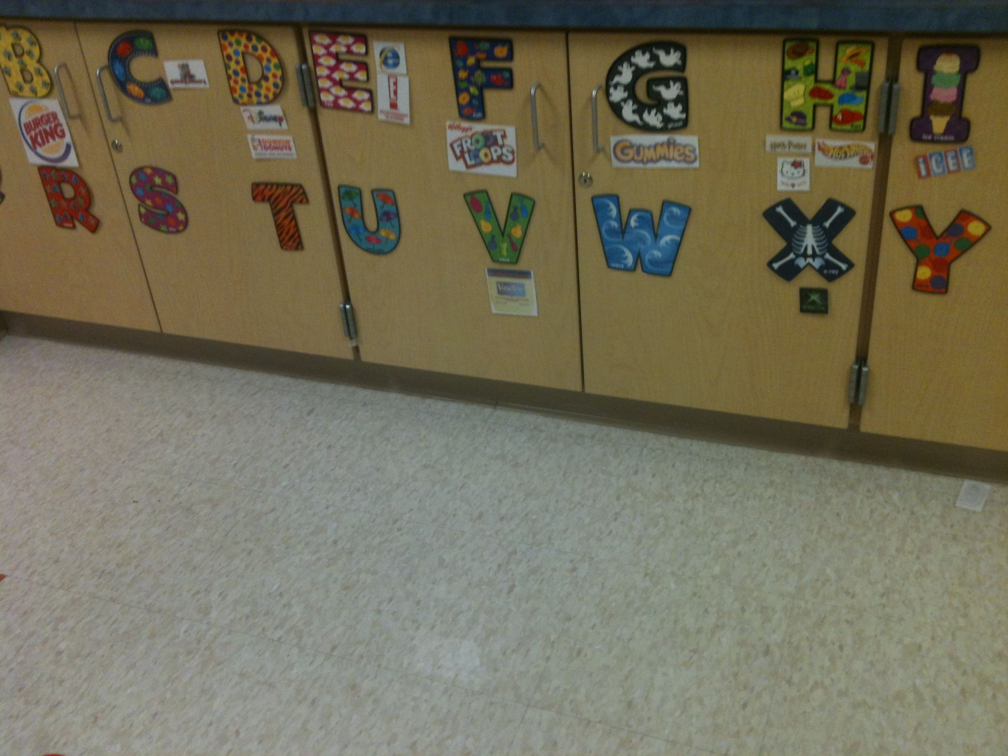 Cabinets used for Environmental Print! Children can bring in all year!