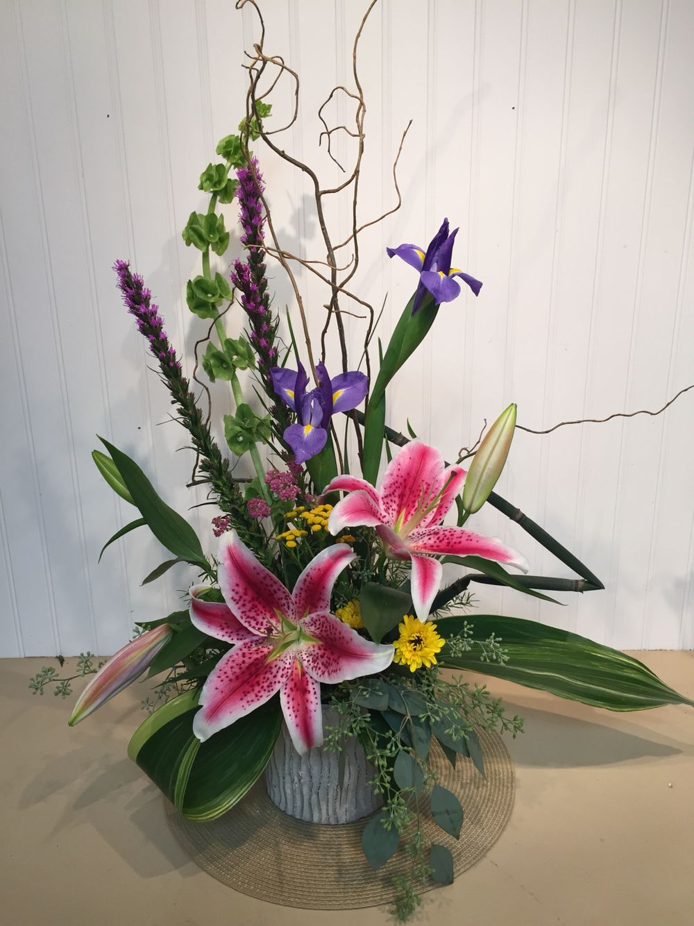 A Contemporary Floral Arrangement With Stargazer Lilies And Iris