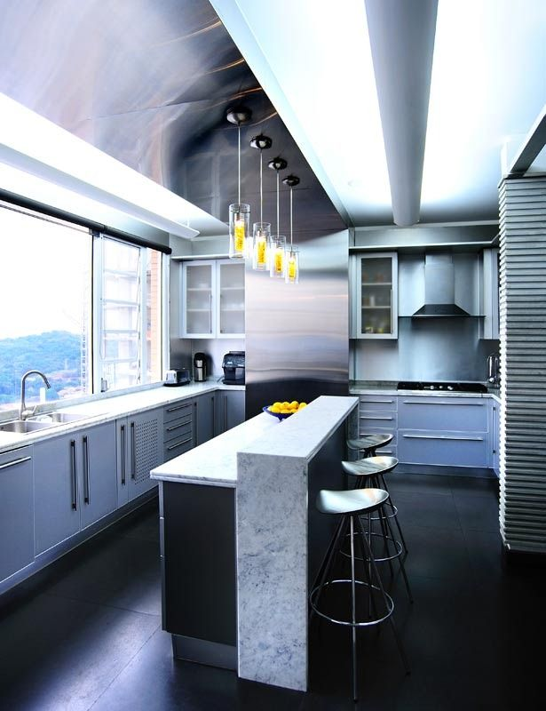 Industrial-style kitchen - architect Ignacio Mallol's Panama City penthouse
