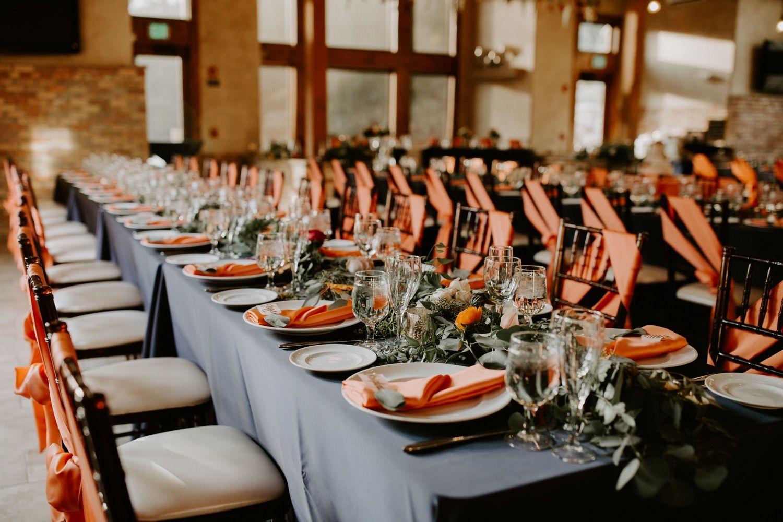 Long banquet tables. chair sashes on each chair. della terra