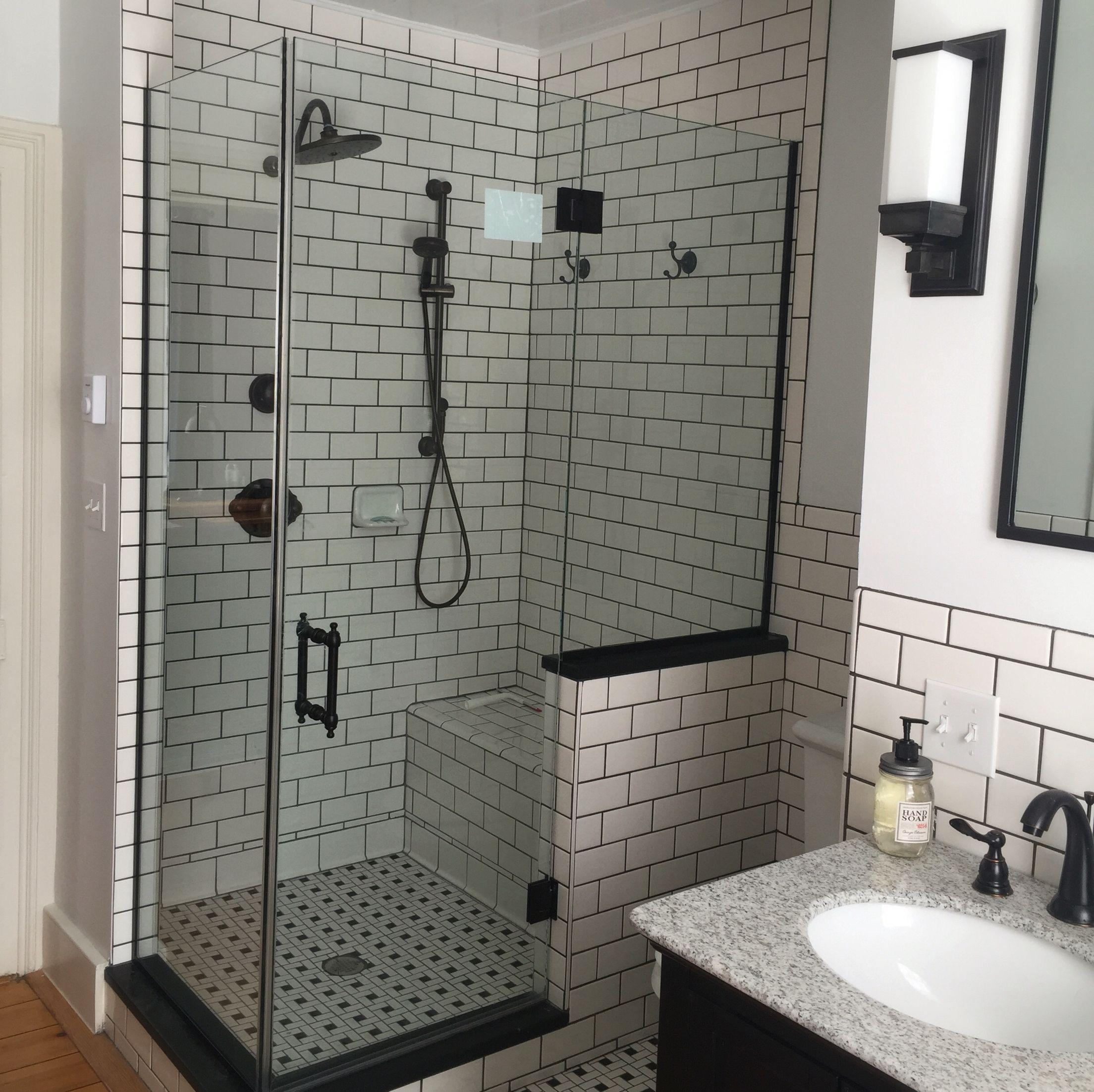 Subway tile shower with dark grey grout moen fixtures for Grey subway tile shower