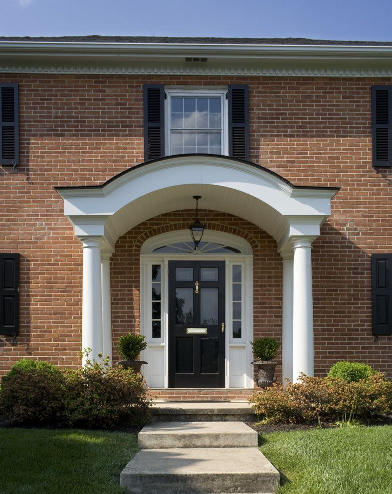 Colonial front doors with storm door in front of it of the for Front entrance storm doors