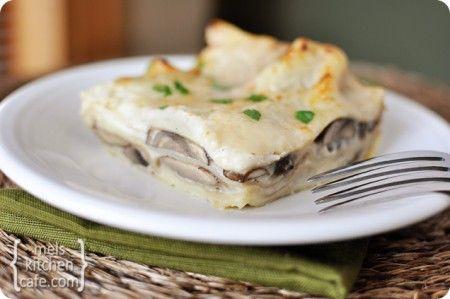 Mushroom Lasagna with White Sauce-mushrooms nestled between layers of noodles with a creamy garlic and cheese infused white sauce.