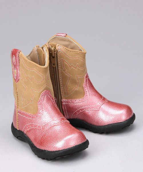 Little lasses will get their Western fix with these cool kicks. Embroidered faux leather uppers and durable rubber soles craft quality boots ideal for everyday wear!4.5'' shaft (measured on size 5)8'' circumferenceZipper closureFaux leather upperCus...