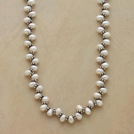 Pretty freshwater pearl necklace with top drilled oval pearls and bali spacers gives the necklace a natural wave and almost looks bead woven. Pretty design from sundance