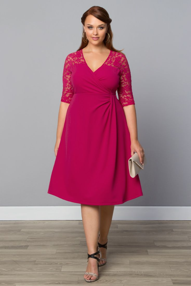 Our plus size Lavish Lace Dress is designed in a bold fuchsia pink with a trendy illusion neckline and sheer lace, 3/4 sleeves. Browse our made in the USA collection at www.kiyonna.com.  #Kiyonna #pinkdresses