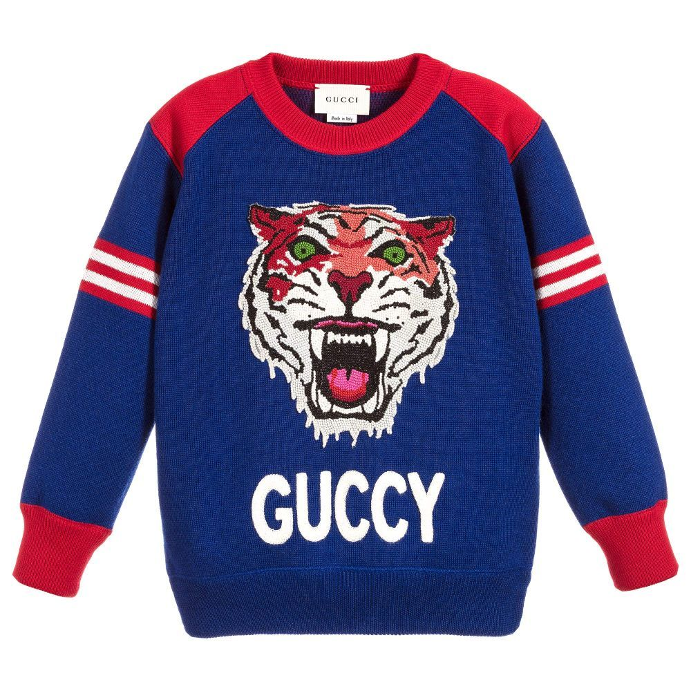 cf82343f4 Made in Italy by luxury designer Gucci, this blue sweater for boys is made  from soft knitted wool. It has a stunning tiger embroidery and an  intentionally ...