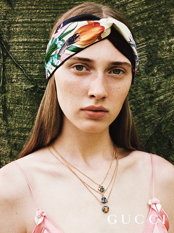 2248ed573cc Discover more gifts from the Gucci Garden. A silk headband features the new  Flora Snake print by Alessandro Michele