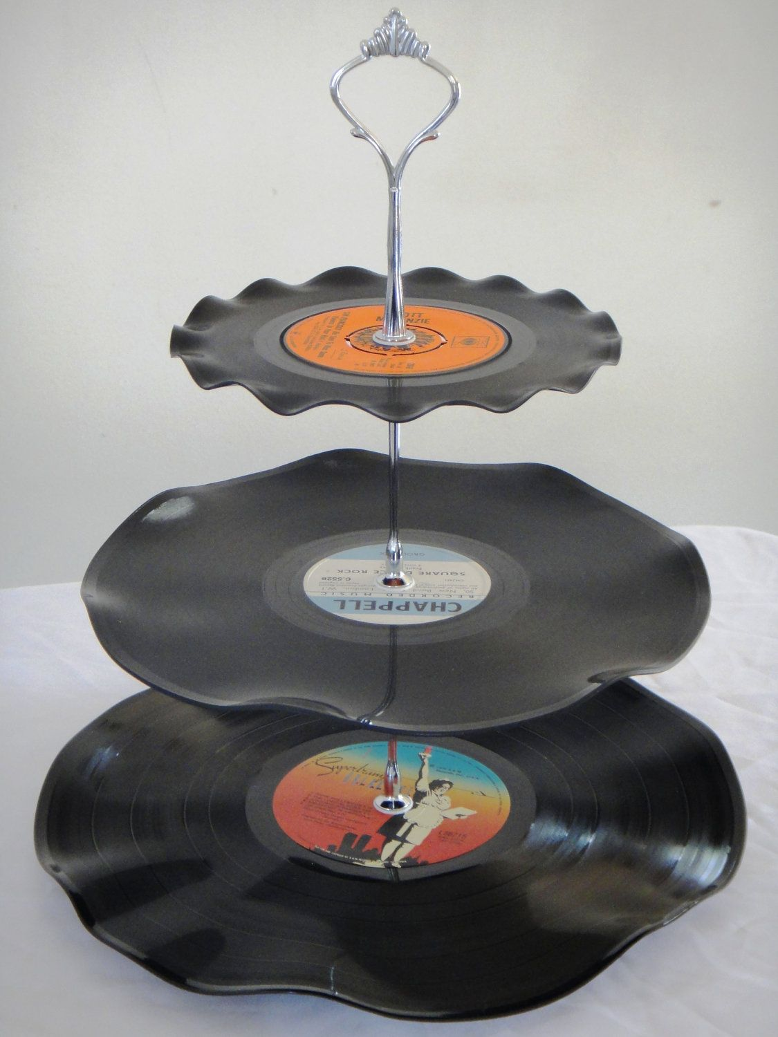 This would be awesome ror a retro party!!  3 Tier Cup Cake Stand Vintage Retro Vinyl Record by myEroom, $20.00..hey we used to make these..put your old 78 records over a upside down pan/bowl..and put in preheated oven for a few seconds..till record melted  to take shape of pan/bowl.. I just bought some 78 records this weekend. Yay.