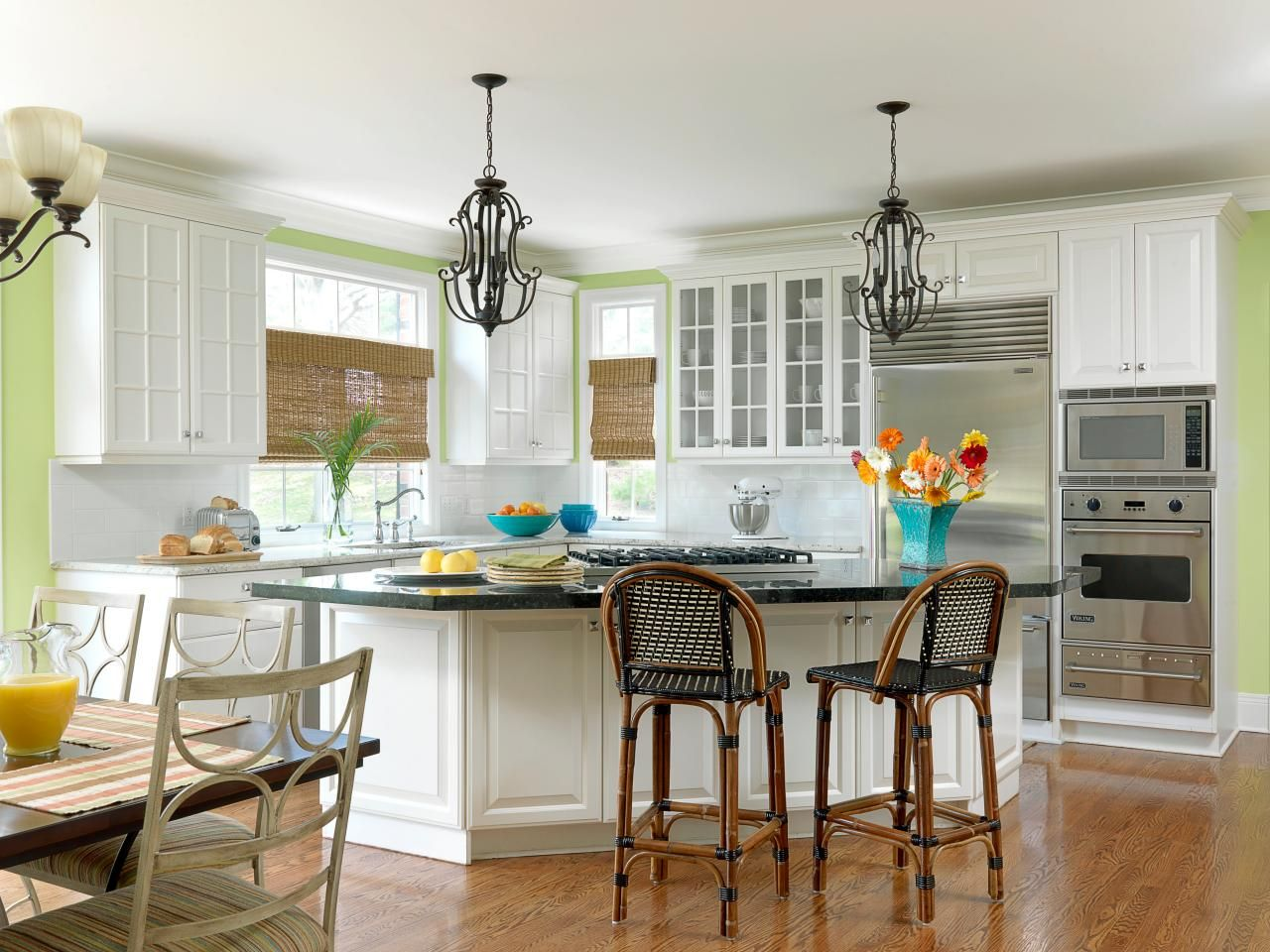 White cabinets crisply contrast with bright green walls in this ...