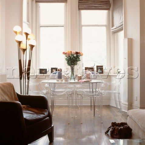 Living Room With Large Sash Windows And Philippe Starck Louis Ghost Chairs Vintage Furniture