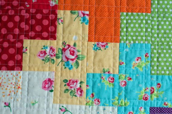 Rainbow plus quilt — bright pluses in front of low-volume pluses