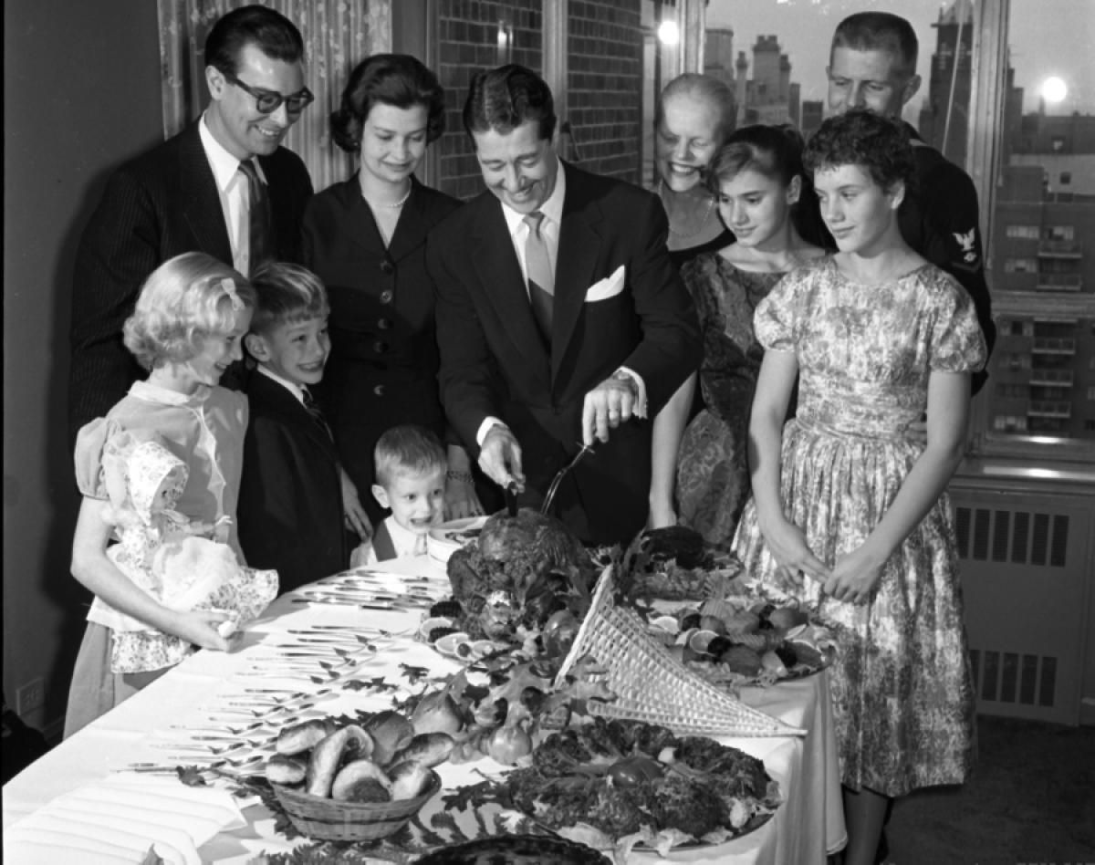 Actor Don Ameche Carves Up A Bird Complete With All The Thanksgiving Fixings For Dinner Family In 1958