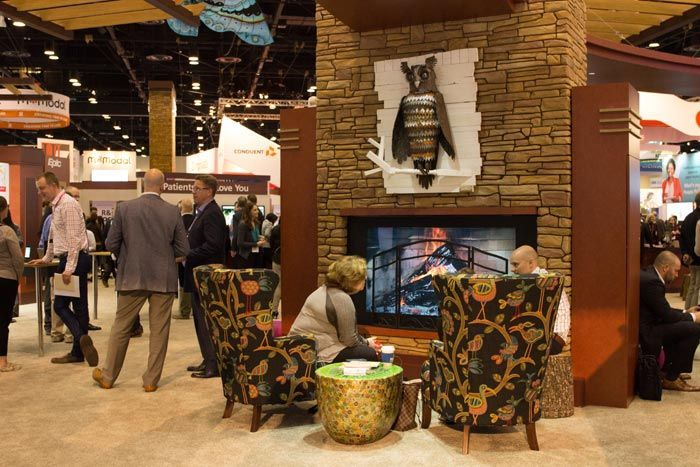 Epic: To make its large 100- by 110-foot booth feel homey, Epic put residential-style furniture in front of a faux fireplace in the center.