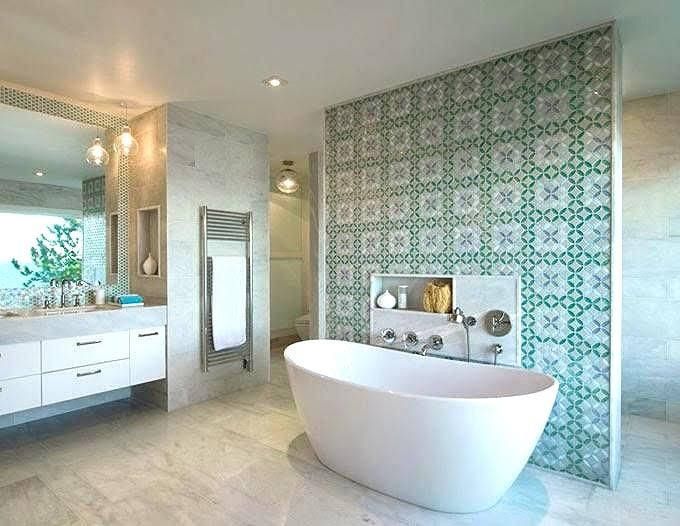 An detailed tile design behind a tub in a master bathroom is great ...