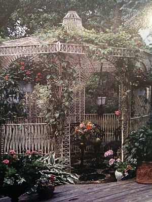 Beautiful little gazebo covered with vines...