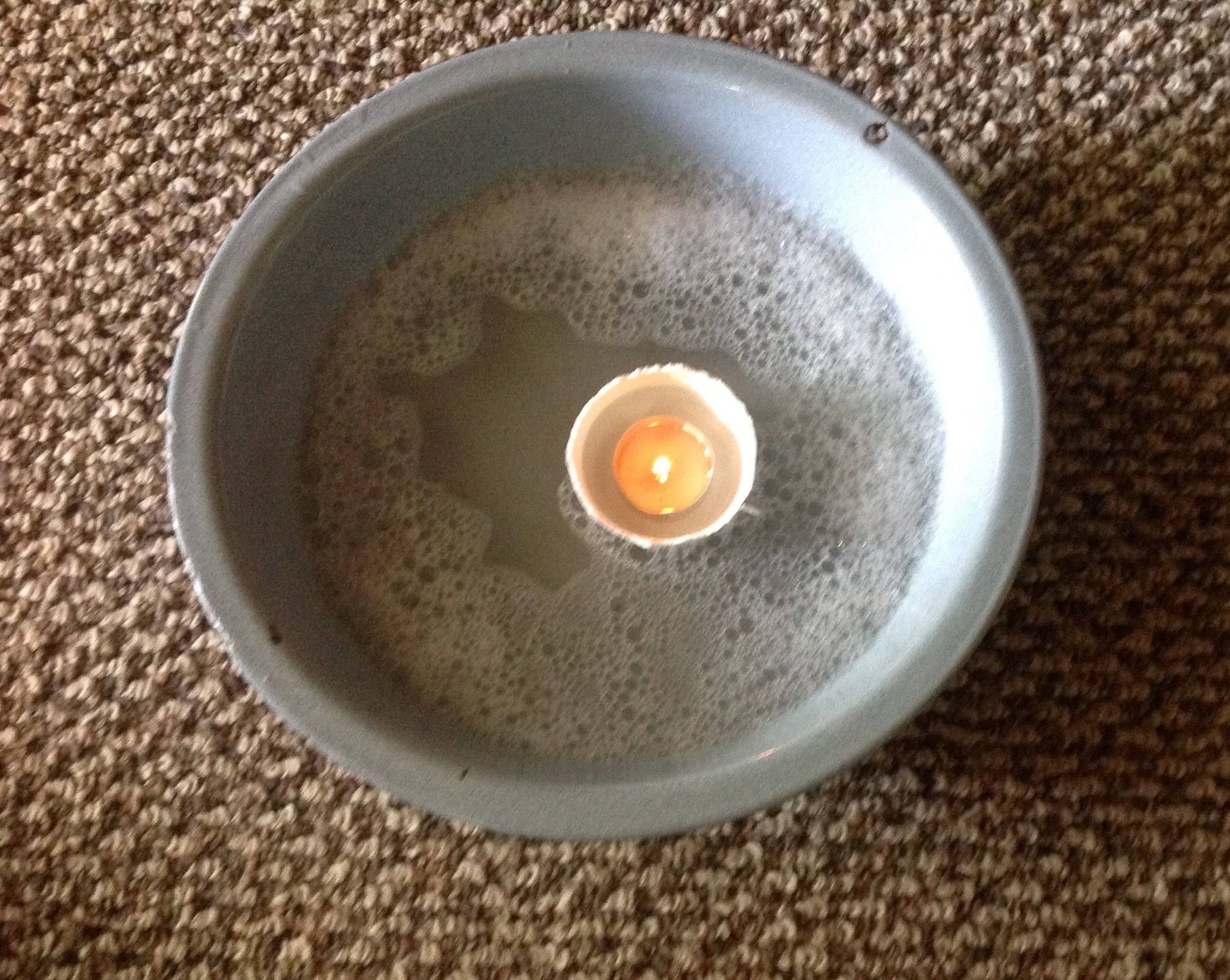 To eradicate fleas from your home, float a lit tea candle