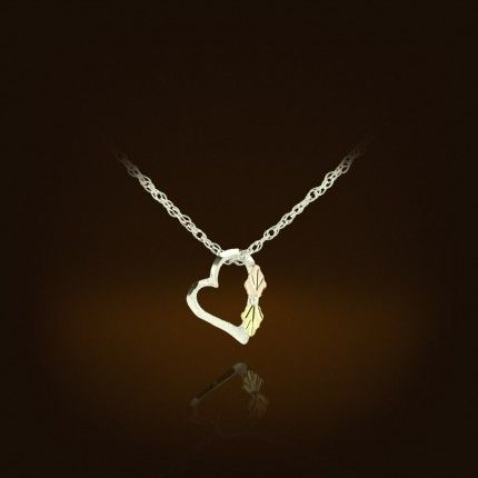 "The unique shape of this sterling silver heart necklace is just the right size at 10mm wide, and featured on an 18""sterling silver chain."
