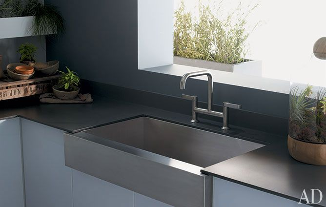 "A contemporary take on a traditional farmhouse sink, Kohler's Vault under-counter stainless-steel basin features a shortened apron front. The model measures 35.5"" l. x 21.25"" w. x 9.25"" h. $850; kohler.com"