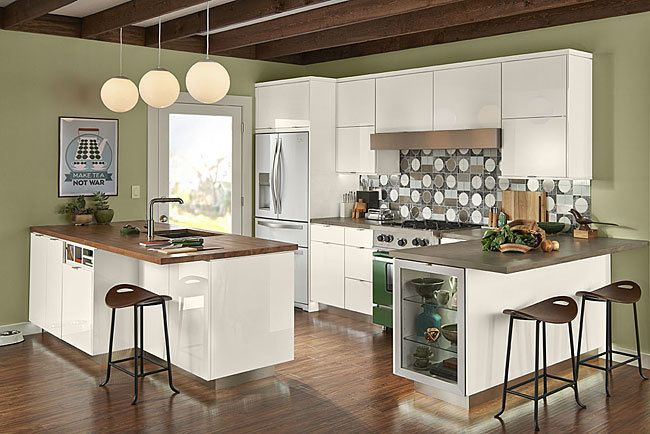 """""""Look ma no handles""""  This clean and contemporary cabinetry from Kraftmaid features one touch doors for easy open and closing.  Ready to start building your dream kitchen with all the latest in modern convenience?  Call to schedule a design appointment 727.327.3007."""